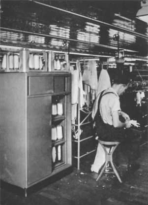 The cabinets in which yarn is stored immediately before placing on the knitting machines