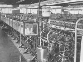 A rear view of a multi-head stocking machine
